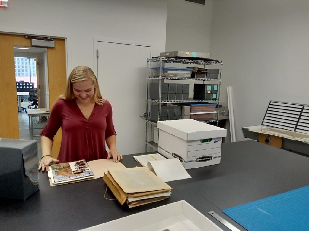 Kelin Baldrige, Project Archivist for the John Rhoden papers surveying the collection.